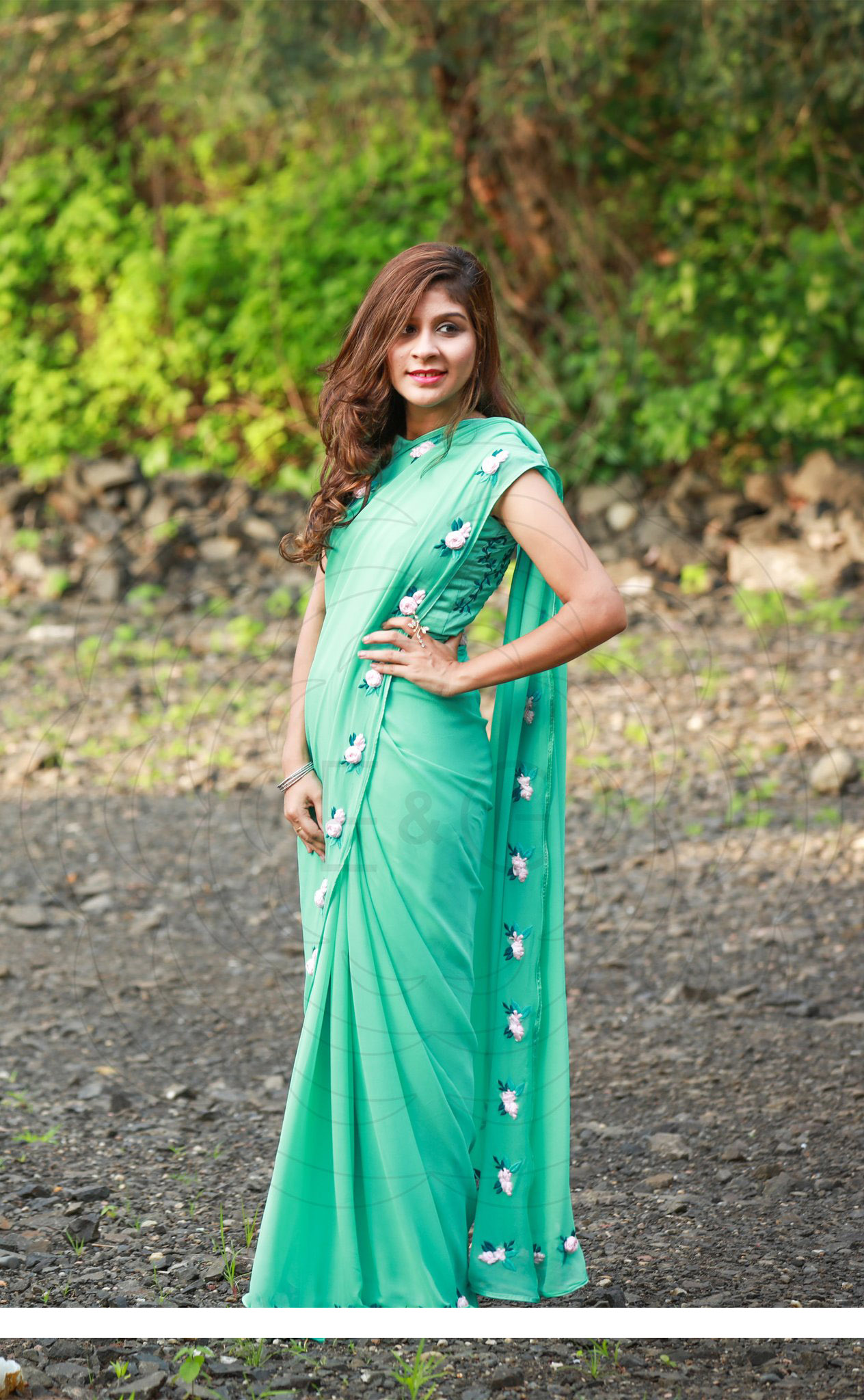 Featuring a sea green pure Georgette Embrodary Work Saree