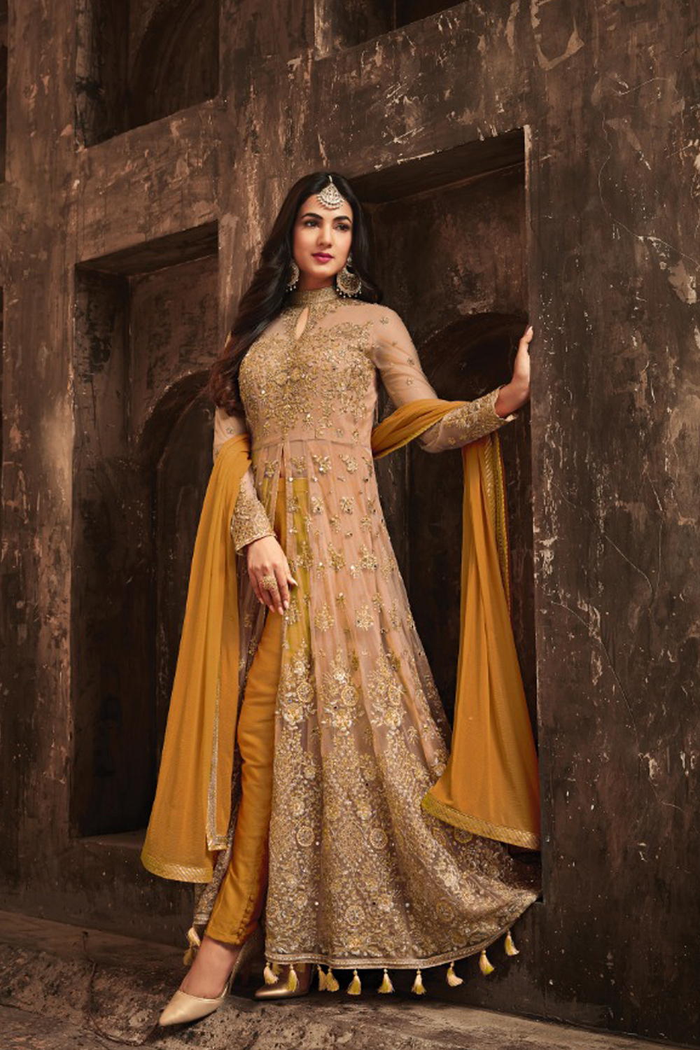 Sonal Chauhan Yellow With Cream Net Top Heavy Designer Suit